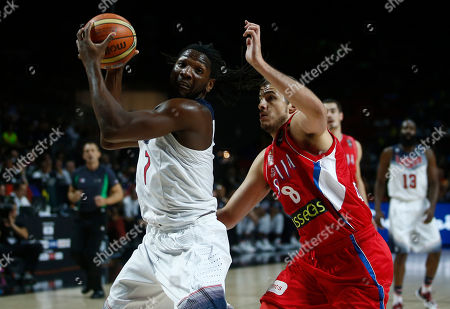 Kenneth Faried, Serbia's Nemanja Bjelica United States' Kenneth Faried, left, shields the ball from Serbia's Nemanja Bjelica during the final World Basketball match between the United States and Serbia at the Palacio de los Deportes stadium in Madrid, Spain