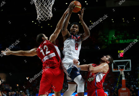Nenad Krstic, Rudy Gay Serbia's Nenad Krstic, left tries to block United States' Rudy Gay as he pushes the ball up to the basket during the final World Basketball match between the United States and Serbia at the Palacio de los Deportes stadium in Madrid, Spain
