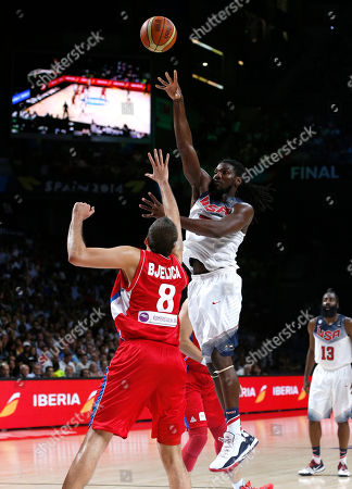Kenneth Faried, Nemanja Bjelica United States' Kenneth Faried pushes the ball up the basket against Serbia's Nemanja Bjelica during the final World Basketball match between the United States and Serbia at the Palacio de los Deportes stadium in Madrid, Spain