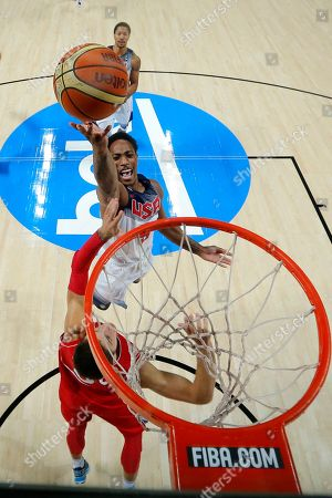 Kenneth Faried United States' Demar Derozan pushes the ball up to the basket during the final World Basketball match between the United States and Serbia at the Palacio de los Deportes stadium in Madrid, Spain