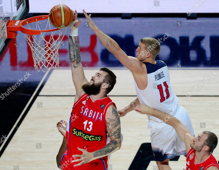 United States' Mason Plumlee, right, and Serbia's Miroslav Raduljica jump for the ball during the final World Basketball match between the United States and Serbia at the Palacio de los Deportes stadium in Madrid, Spain