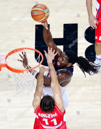 United States' Kenneth Faried, right, and Serbia's Stefan Bircevic vie for the ball during the final World Basketball match between the United States and Serbia at the Palacio de los Deportes stadium in Madrid, Spain