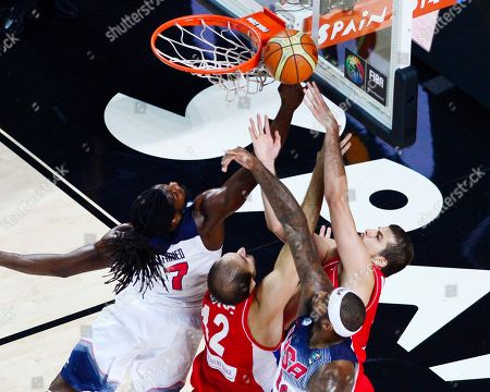United States' Kenneth Faried, left, and Serbia's Nenad Krstic vie for the ball during the final World Basketball match between the United States and Serbia at the Palacio de los Deportes stadium in Madrid, Spain