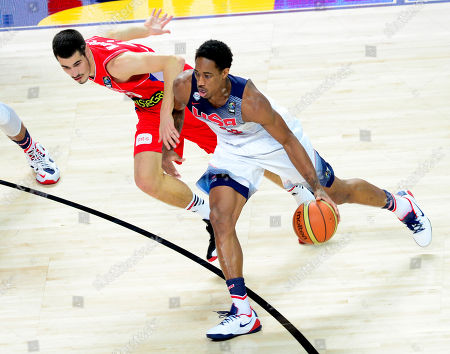 United States' Rudy Gay, right, and Serbia's Rasko Katic vie for the ball during the final World Basketball match between the United States and Serbia at the Palacio de los Deportes stadium in Madrid, Spain