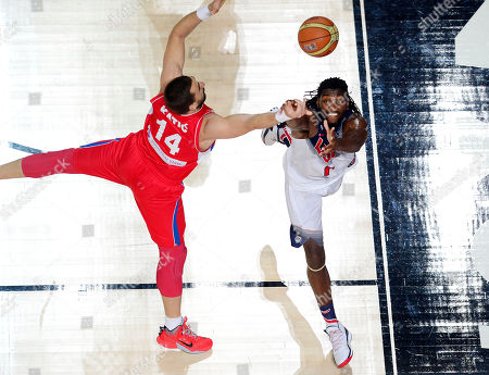 United States' Kenneth Faried, right, and Serbia's Rasko Katic vie for the ball during the final World Basketball match between the United States and Serbia at the Palacio de los Deportes stadium in Madrid, Spain
