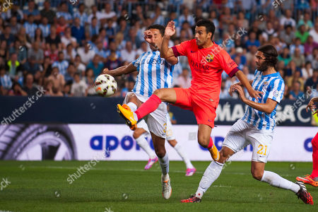 Welligton Robson, Pedro Rodriguez, Sergio Sanchez FC Barcelona's Pedro Rodriguez, center, in action with Malaga's Welligton Robson Pena de Oliveira from Brazil, left, and CF Malaga's Sergio Sanchez, right, during a Spanish La Liga soccer match between Malaga and Barcelona at La Rosaleda stadium in Malaga, Spain