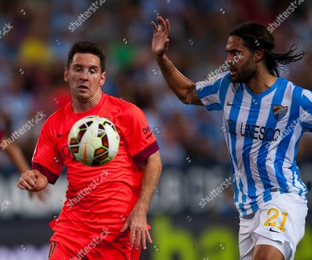 Lionel Messi, Sergio Sanchez FC Barcelona's Lionel Messi from Argentina, left, in action with Malaga's Sergio Sanchez, right, during a Spanish La Liga soccer match between Malaga and Barcelona at La Rosaleda stadium in Malaga, Spain