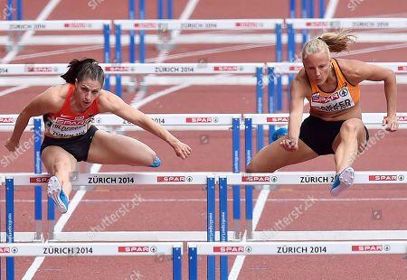 Germany's Nadine Hildebrand, left, and Netherlands' Sharona Bakker compete in a women's 100m hurdles first round heat during the European Athletics Championships in Zurich, Switzerland