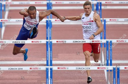 Britain's William Sharman, left, and Poland's Dominik Bochenek compete in a men's 110m hurdles first found heat during the European Athletics Championships in Zurich, Switzerland