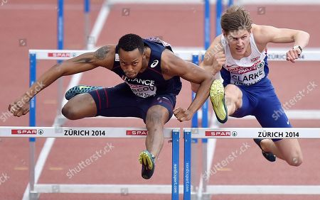 France's Dimitri Bascou, left, and Britain's Lawrence Clarke compete in a men's 110m hurdles first found heat during the European Athletics Championships in Zurich, Switzerland
