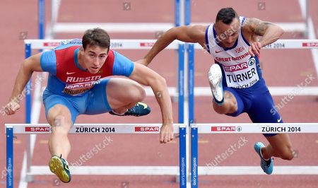 Stock Photo of Russia's Sergey Shubenkov, left, and Britain's Andy Turner compete in a men's 110m hurdles first found heat during the European Athletics Championships in Zurich, Switzerland