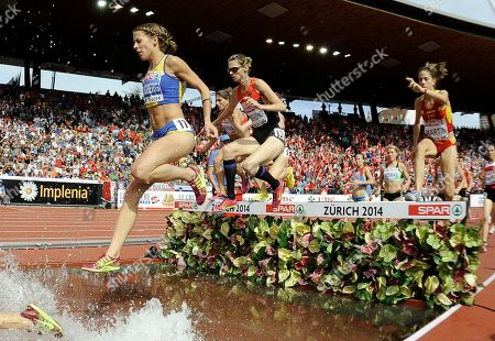 Sweden's silver medal winner Charlotta Fougberg, Germany's gold medal winner Antje Moeldner-Schmidt and Spain's bronze medal winner Diana Martin compete in the women's 3000m steeplechase final during the European Athletics Championships in Zurich, Switzerland