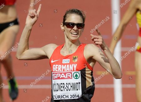Germany's Antje Moeldner-Schmidt celebrates after winning the gold medal in the women's 3000m steeplechase final during the European Athletics Championships in Zurich, Switzerland