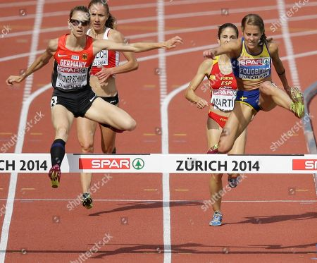 Germany's gold medal winner Antje Moeldner-Schmidt, left, and Sweden's silver medal winner Charlotta Fougberg clear the last obstacle in the women's 3000m steeplechase final during the European Athletics Championships in Zurich, Switzerland