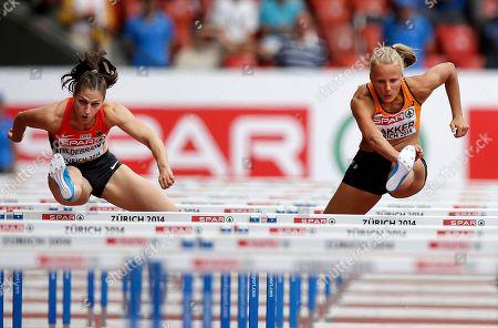 Germany's Nadine Hildebrand, left, and Netherland's Sharona Bakker clear hurdles in their 100m hurdles heat during the European Athletics Championships in Zurich, Switzerland