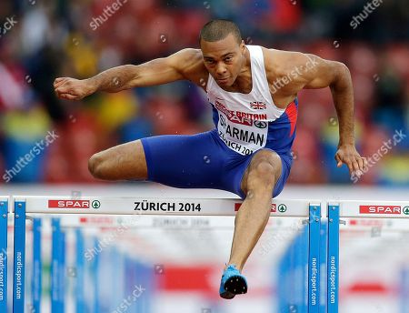 Britain's William Sharman clears a hurdle in his 110m hurdles heat during the European Athletics Championships in Zurich, Switzerland
