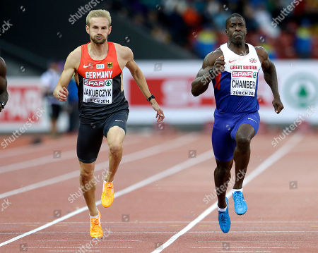 Britain's Dwain Chambers, right, and Germany's Lucas Jakubczyk run in their 100m semifinal during the European Athletics Championships in Zurich, Switzerland