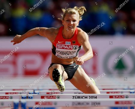 Germany's Lilli Schwarzkopf clears a hurdle in the 100m hurdles heat of the heptathlon during the European Athletics Championships in Zurich, Switzerland