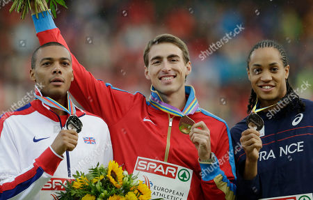 Russia's winner Sergey Shubenkov, center, 2nd place winner William Sharman of Britain, left, and third place winner Pascal Martinot -Lagarde of France show the medals they won in the 110m hurdles final during the European Athletics Championships in Zurich, Switzerland