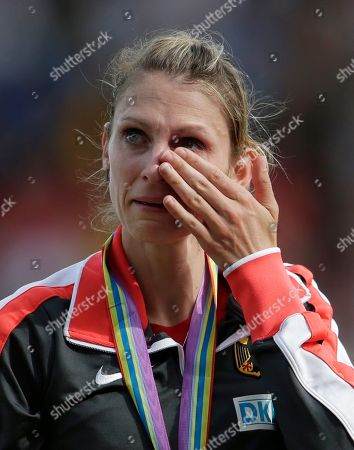 Stock Picture of Germany's gold medal winner Antje Moldner-Schmidt wipes her eye during the victory ceremony for the women's 3000m steeplechase final during the European Athletics Championships in Zurich, Switzerland