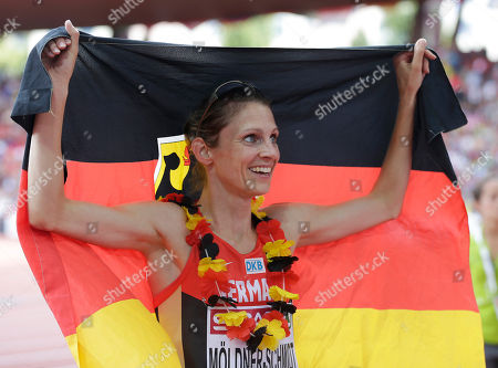 Stock Image of Germany's Antje Moldner-Schmidt holds the national flag after winning the 3000m steeplechase final during the European Athletics Championships in Zurich, Switzerland