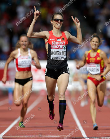 Stock Photo of Germany's Antje Moldner-Schmidt crosses the finish line to win the women's 3000m steeplechase final during the European Athletics Championships in Zurich, Switzerland