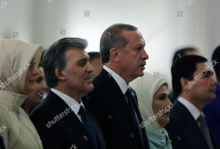 """Stock Picture of Recep Tayyip Erdogan, Abdullah Gul, Hayrunnisa Gul, Emine Erdogan Turkey's new President Recep Tayyip Erdogan, center, his wife Emine Erdogan, second right, outgoing president Abdullah Gul, second left, and his wife Hayrunnisa Gul stand during a ceremony where he formally took charge of the presidency from his predecessor, Abdullah Gul, at the Cankaya Palace in Ankara, Turkey, . Erdogan said that as the first president to be elected by the people _ instead of parliament _ his tenure would usher in an era of a """"new Turkey, a great Turkey"""