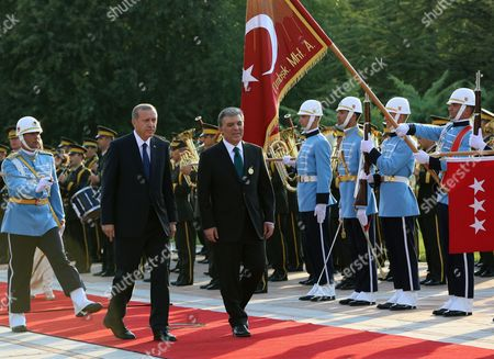 """Recep Tayyip Erdogan, Abdullah Gul Turkey's new President Recep Tayyip Erdogan, center, and outgoing president Abdullah Gul inspect an honour guard after a handover ceremony at the Cankaya Palace in Ankara, Turkey, . Erdogan said that as the first president to be elected by the people _ instead of parliament _ his tenure would usher in an era of a """"new Turkey, a great Turkey"""