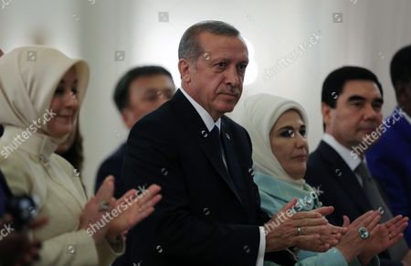 """Recep Tayyip Erdogan, Emine Erdogan, Hayrunnisa Gul Turkey's new President Recep Tayyip Erdogan, center, his wife Emine Erdogan, second right, and Hayrunnisa Gul, the wife of outgoing president Abdullah Gul, applaud during a ceremony where he formally took charge of the presidency from his predecessor, Abdullah Gul, at the Cankaya Palace in Ankara, Turkey, . Erdogan said that as the first president to be elected by the people _ instead of parliament _ his tenure would usher in an era of a """"new Turkey, a great Turkey"""