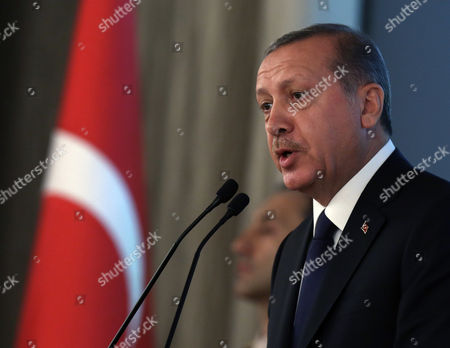 """Recep Tayyip Erdogan Turkey's new President Recep Tayyip Erdogan speaks during a ceremony where he formally took charge of the presidency from his predecessor, Abdullah Gul, at the Cankaya Palace in Ankara, Turkey, . Erdogan said that as the first president to be elected by the people _ instead of parliament _ his tenure would usher in an era of a """"new Turkey, a great Turkey"""