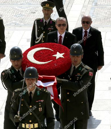 """Recep Tayyip Erdogan Turkey's new President Recep Tayyip Erdogan, rear-center, follows a military honour guard as he visits the mausoleum of modern Turkey's founder, Kemal Ataturk, before a ceremony where he formally took charge of the presidency from his predecessor, Abdullah Gul, at the Cankaya Palace in Ankara, Turkey, . Erdogan said that as the first president to be elected by the people _ instead of parliament _ his tenure would usher in an era of a """"new Turkey, a great Turkey"""