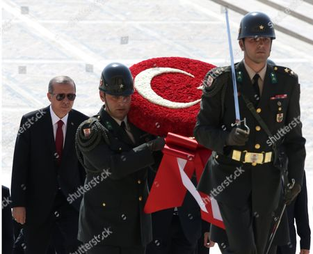 """Recep Tayyip Erdogan Turkey's new President Recep Tayyip Erdogan follows a military honour guard as he visits the mausoleum of modern Turkey's founder, Kemal Ataturk, before a ceremony where he formally took charge of the presidency from his predecessor, Abdullah Gul, at the Cankaya Palace in Ankara, Turkey, . Erdogan said that as the first president to be elected by the people _ instead of parliament _ his tenure would usher in an era of a """"new Turkey, a great Turkey"""