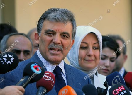 Stock Image of Abdullah Gul, Hayrunnisa Gul Turkey's President Abdullah Gul speaks to the media with his wife Hayrunnisa Gul after they have cast their votes for the Turkey's presidential election at a polling station in Ankara, Turkey, on . Turks were voting in their first direct presidential election Sunday - a watershed event in Turkey's 91-year history, where the president was previously elected by Parliament. Prime Minister RecepTayyip Erdogan, who has dominated the country's politics for the past decade, is the strong front-runner to replace the incumbent, Abdullah Gul, for a five-year term