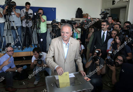 Ekmeleddin Ihsanoglu Ekmeleddin Ihsanoglu, the main opposition candidate in the presidential election, casts his vote at a polling station in Istanbul, Turkey, on . Turks were voting in their first direct presidential election Sunday - a watershed event in Turkey's 91-year history, where the president was previously elected by Parliament. Prime Minister Recep Tayyip Erdogan, who has dominated the country's politics for the past decade, is the strong front-runner to replace the incumbent, Abdullah Gul, for a five-year term