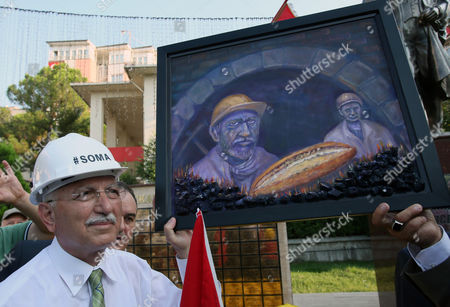 Ekmeleddin Ihsanoglu The main opposition candidate in Turkey's Aug. 10 presidential election, Ekmeleddin Ihsanoglu, receives a painting depicting miners as he visits the monument of 301 miners killed in a mine catastrophe in May, in Soma, Turkey, . Some 53 million Turks go the polls on Sunday to choose their 12th president in an election considered a turning point for the country of 76 million people, with Prime Minister Recep Tayyip Erdogan vying for the position he has pledged to transform from a symbolic role into a position of power. Ekmeleddin Ihsanoglu, the former chief of the Organization of Islamic Cooperation, and Kurdish politician Selahattin Demirtas are also running