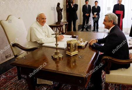 Pope Francis meets with Armenia's President Serge Sarkisian during their private audience in the pontiff's private studio, at the Vatican