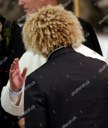 Pope Francis blesses Colombia's Carlos Valderrama in the Paul VI hall at the Vatican, ahead of an inter-religious match for peace. The friendly soccer match, supported by Pope Francis to promote the dialogue and peace among different religions, is scheduled at Rome's Olympic stadium later Monday