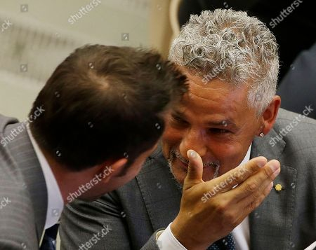 Soccer legend Roberto Baggio, right, talks to Alessandro Del Piero as they wait to meet Pope Francis in the Paul VI hall at the Vatican, ahead of an inter-religious match for peace. The friendly soccer match, supported by Pope Francis to promote the dialogue and peace among different religions, is scheduled at Rome's Olympic stadium later Monday
