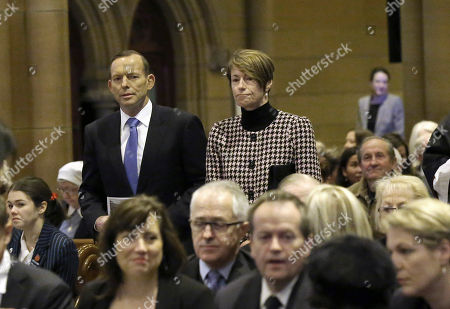 Stock Image of Tony Abbott, Margie Abbott Australia's Prime Minister and his wife Margie arrive at St. Mary's Cathedral for a church service commemorating victims of Malaysia Airlines Flight 17, in Sydney, Australia, . Abbott was joined by dignitaries including opposition leader Bill Shorten, the Governor General Sir Peter Cosgrove, New South Wales Governor Marie Bashir and other parishioners who all came to pay their respect for the 298 people killed in the tragedy
