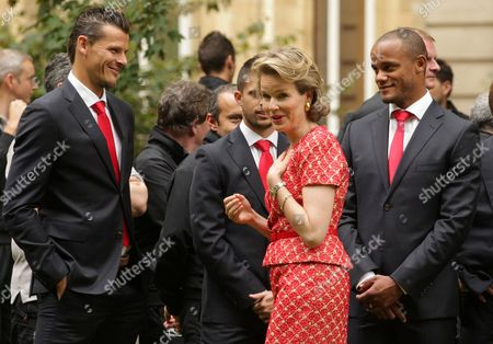 Dries Mertens, Vital Borkelmans Belgian Queen Mathilde, centre, talks with players of the Belgian national soccer team, Daniel Van Buyten, left, and team captain Vincent Kompany, right, at an event held after the team's return from Brazil, at the Royal Palace in Brussels, . Belgium were knocked out after a 1-0 loss to Argentina in the quarterfinals