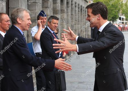 Mak Rutte, Yves Leterme Dutch Prime Minister Mark Rutte, right, greets former Belgian Prime Minister Yves Leterme, as he arrives at the Cloth Hall for an EU Summit meeting in Ypres, Belgium on . Where their countrymen once slaughtered each other with machine guns, artillery and poison gas, the leaders of Britain, Germany and the other member states of the European Union gather Thursday to solemnly mark the 100th anniversary of the start of World War I and rededicate themselves to peace and working together