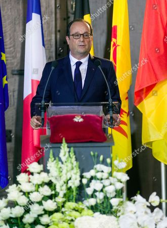 French President Francois Holland attends a commemoration ceremony to mark the 100th anniversary of the outbreak of World War I, and to present the Legion of Honour medal to the Liege Mayor Willy Demeyer, at the Town Hall in Liege, Belgium on . The national ceremony pays homage to the numerous victims of the war, both soldiers and civilians, from both Belgium and abroad who lost their lives on Belgian soil