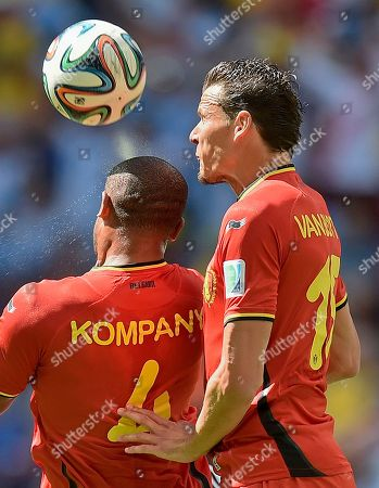 Belgium's Vincent Kompany, left, and Daniel Van Buyten clear the ball during the World Cup quarterfinal soccer match between Argentina and Belgium at the Estadio Nacional in Brasilia, Brazil