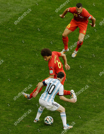 Argentina's Lionel Messi (10) controls the ball against Belgium's Axel Witsel and Daniel Van Buyten, top, during the World Cup quarterfinal soccer match between Argentina and Belgium at the Estadio Nacional in Brasilia, Brazil