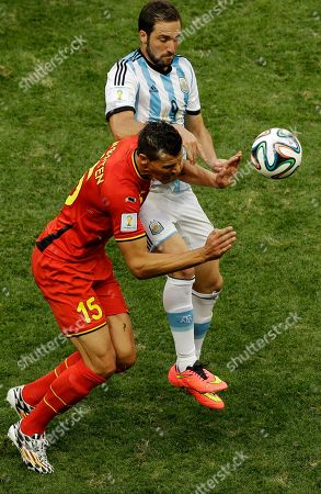 Argentina's Gonzalo Higuain and Belgium's Daniel Van Buyten fight for the ball during the World Cup quarterfinal soccer match between Argentina and Belgium at the Estadio Nacional in Brasilia, Brazil