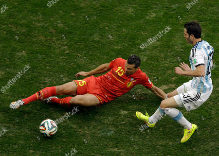 Belgium's Daniel Van Buyten, left, and Argentina's Jose Maria Basanta fight for the ball during the World Cup quarterfinal soccer match between Argentina and Belgium at the Estadio Nacional in Brasilia, Brazil