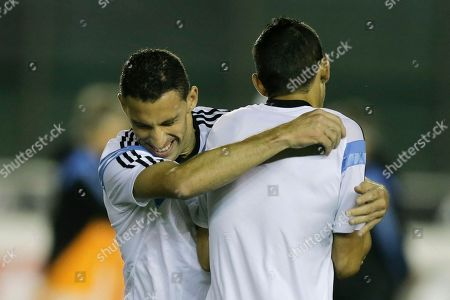 Maxi Rodriguez, Angel di Maria Argentina's Maxi Rodriguez, left, hugs teammate Angel di Maria, right, during an official training session at Vasco da Gama Stadium a day before the World Cup soccer final between Germany and Argentina in Rio de Janeiro, Brazil