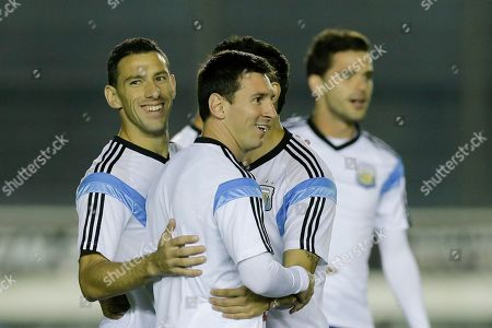 Lionel Messi, Maxi Rodriguez, Fernando Gago Argentina's Lionel Messi, center, Maxi Rodriguez, left, and Fernando Gago, right, take part in an official training session at Vasco da Gama Stadium a day before the World Cup soccer final between Germany and Argentina in Rio de Janeiro, Brazil