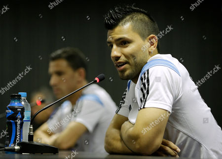 Sergio Aguero, Maxi Rodriguez Argentina's Sergio Aguero, right, speaks during a news conference next to teammate Maxi Rodriguez, left, in Vespesiano, near Belo Horizonte, Brazil, . On Sunday, Argentina faces Germany for the World Cup final soccer match in Rio de Janeiro