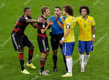 Germany's Thomas Mueller and Brazil's David Luiz argue as referee Marco Rodriguez from Mexico mediates during the World Cup semifinal soccer match between Brazil and Germany at the Mineirao Stadium in Belo Horizonte, Brazil